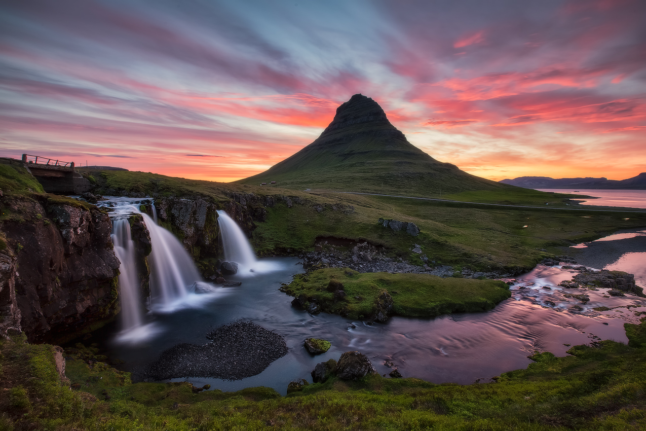 Kirkjufellsfos with Kirkjufell in the background Photo courtesy Iceland Photo Tours